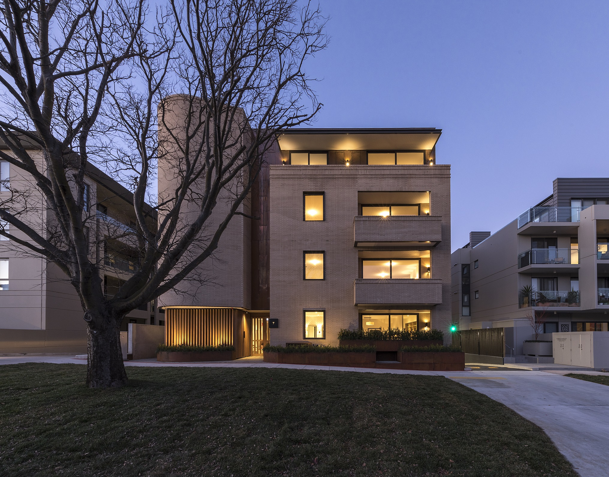Mercer Apartments Outside at night Preferred Builders